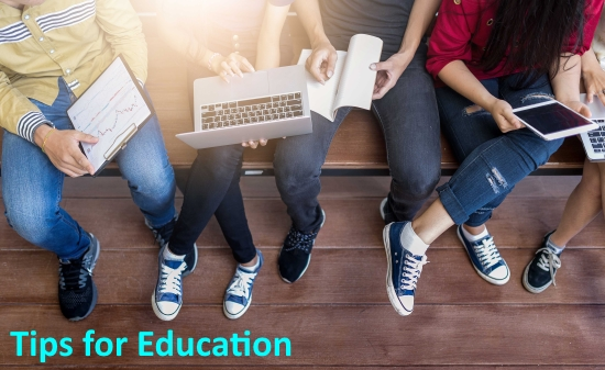 "Students sitting on a bench holding laptops and tablets and clipboards. ""Tips for Education"""