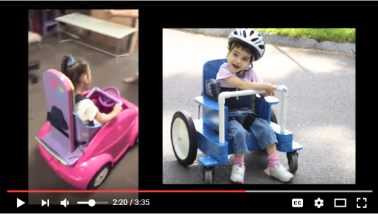 A YouTube screenshot of two girls in do-it-yourself mobility devices. One is an adapted toy car using PVC pipe on the steering wheel and adapted seating. Another is a homemade wheelchair that allows the child to propel with her feet.
