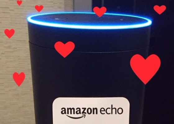 An Amazon Echo with graphic hearts scattered over the image