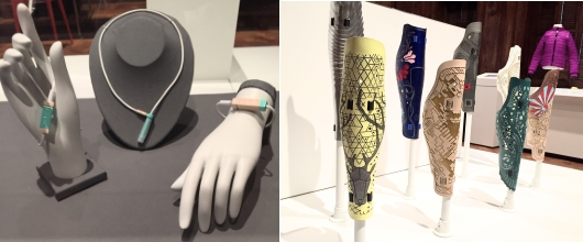 Two museum displays: one of loop jewelry worn on wrist and neck. The other of textured, colorful, stylized prosthetic leg covers