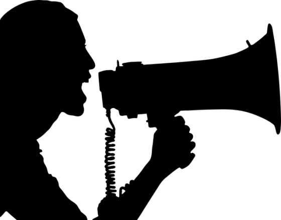 Silhouette of a woman yelling into a bullhorn