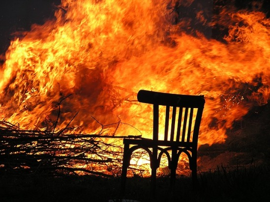 A brush fire with a burning chair