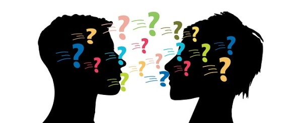 Profile silhouettes of a man and woman's heads facing each other with question marks between them.