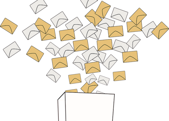A cloud of envelopes in two different shades descending into a box