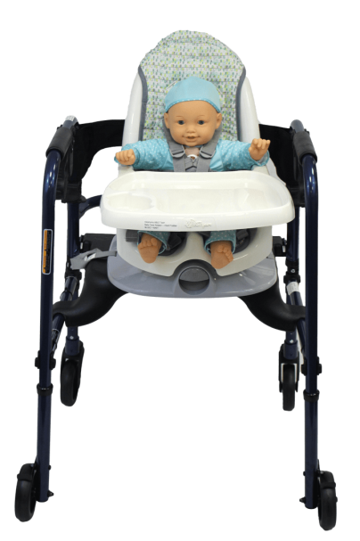 A doll seated in a booster seat with a tray mounted to a rollator with height adjustment.