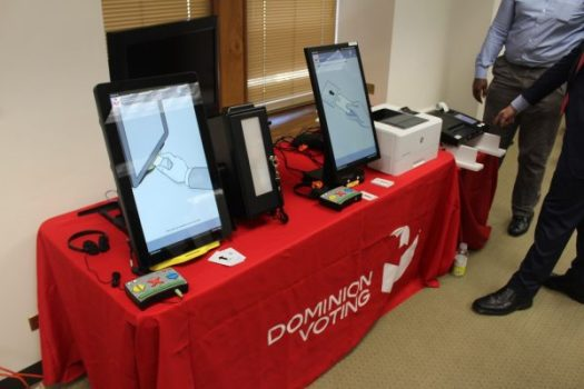 Dominion voting equipment with ballot printers.