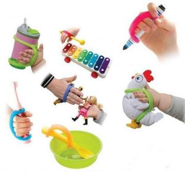 Multiple examples of EasyHold in use including with a sippy cup, a marker, a plush rooster, toy figures, a toothbrush, a spoon and a xylophone mallet.