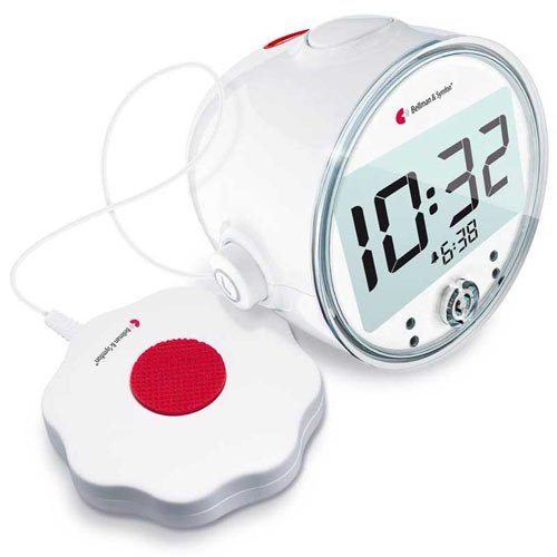 A round modern clock with a bright digital display and a cord-attached disc