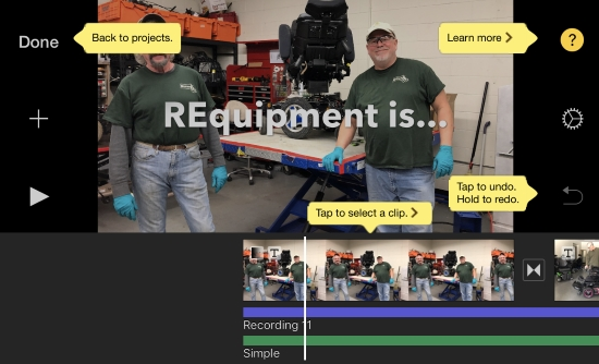 iMovie app screenshot shows project timeline with two audio tracks one labeled recording 1, the other labeled Simple. Shows image of men with a powerchair on a workbench and the title REquipment is... centered on thumbnail image. iMovie help labels highlight how to tap to select a clip, tap to undo. Hold to redo. And Learn more icon.