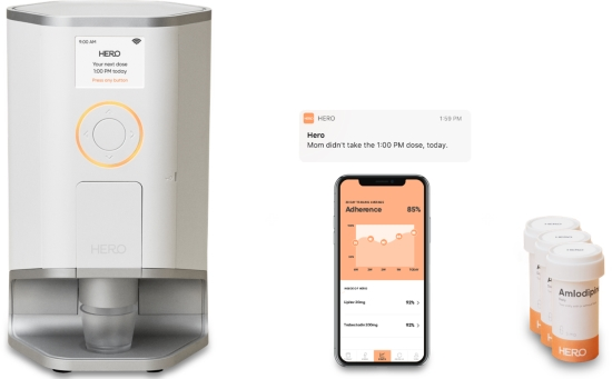 3 images: First is a large counter-top pill dispensing appliance, second is an app displayed on a phone, third are pill bottles. Above the phone is a Hero notification banner