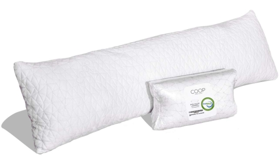 "Long narrow quilted pillow with zippered pouch and label with ""Coop"" brand."