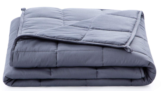 A folded comforter.