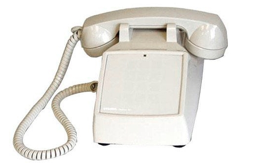 A table-top phone with conventional corded handset that's missing it's dial pad.