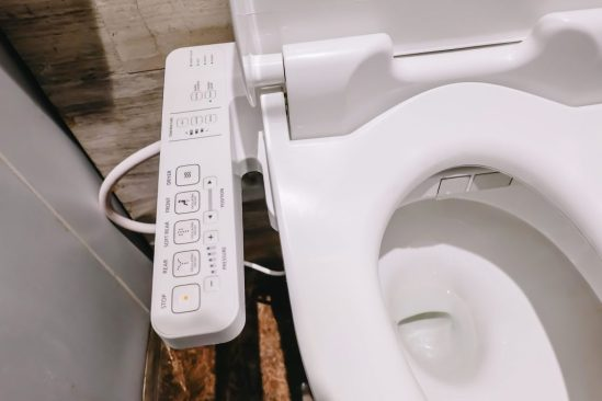 Shows bidet controls with buttons for stop, rear, dryer, temperature, pressure, and position.soft rear, front