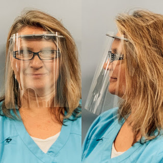 A woman wearing eyeglasses and a face shield, front and profile views.