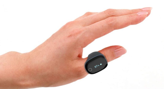 A hand wearing a sleek pulse oximeter on its thumb with a readout of 97%.