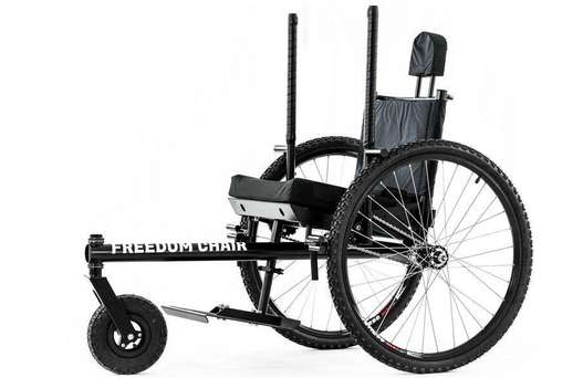 A manual all-terrain wheelchair with knobby tires and an extended single front wheel.