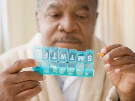 A man using a pill box