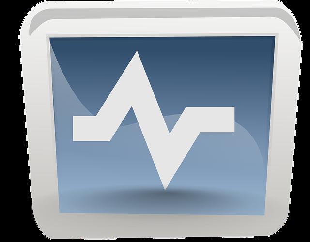 A monitor displays an EKG.