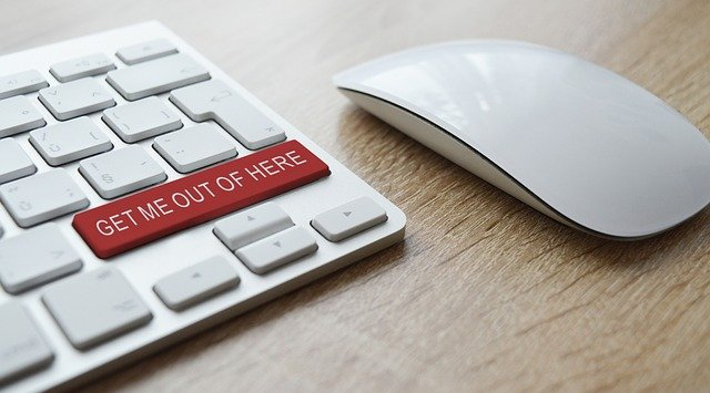 """Mouse and keyboard with """"get me out of here"""" button."""